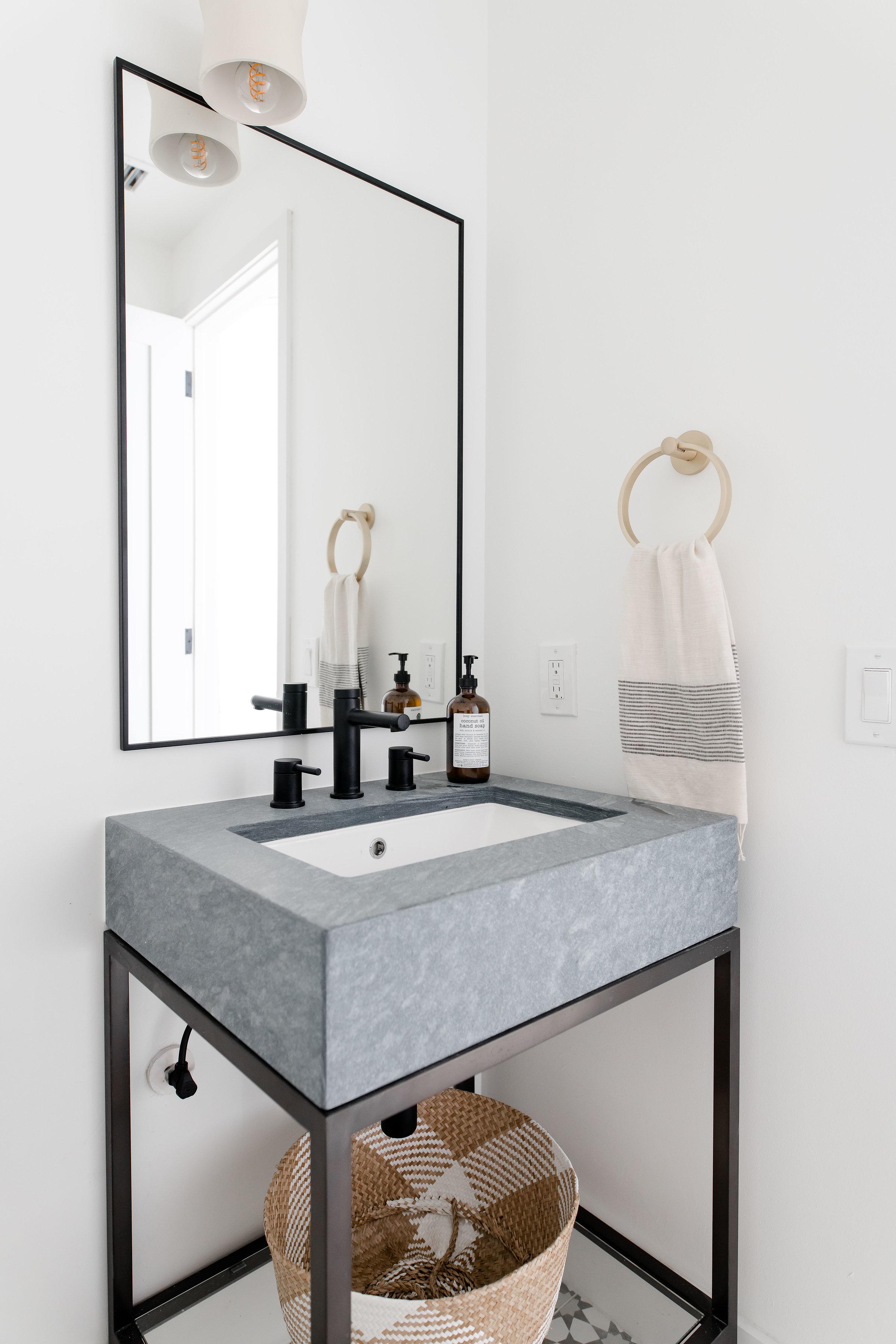 modern powder bathroom, grey marble metal base vanity, patterned tile floors  - the habitat collective - project casinha linda