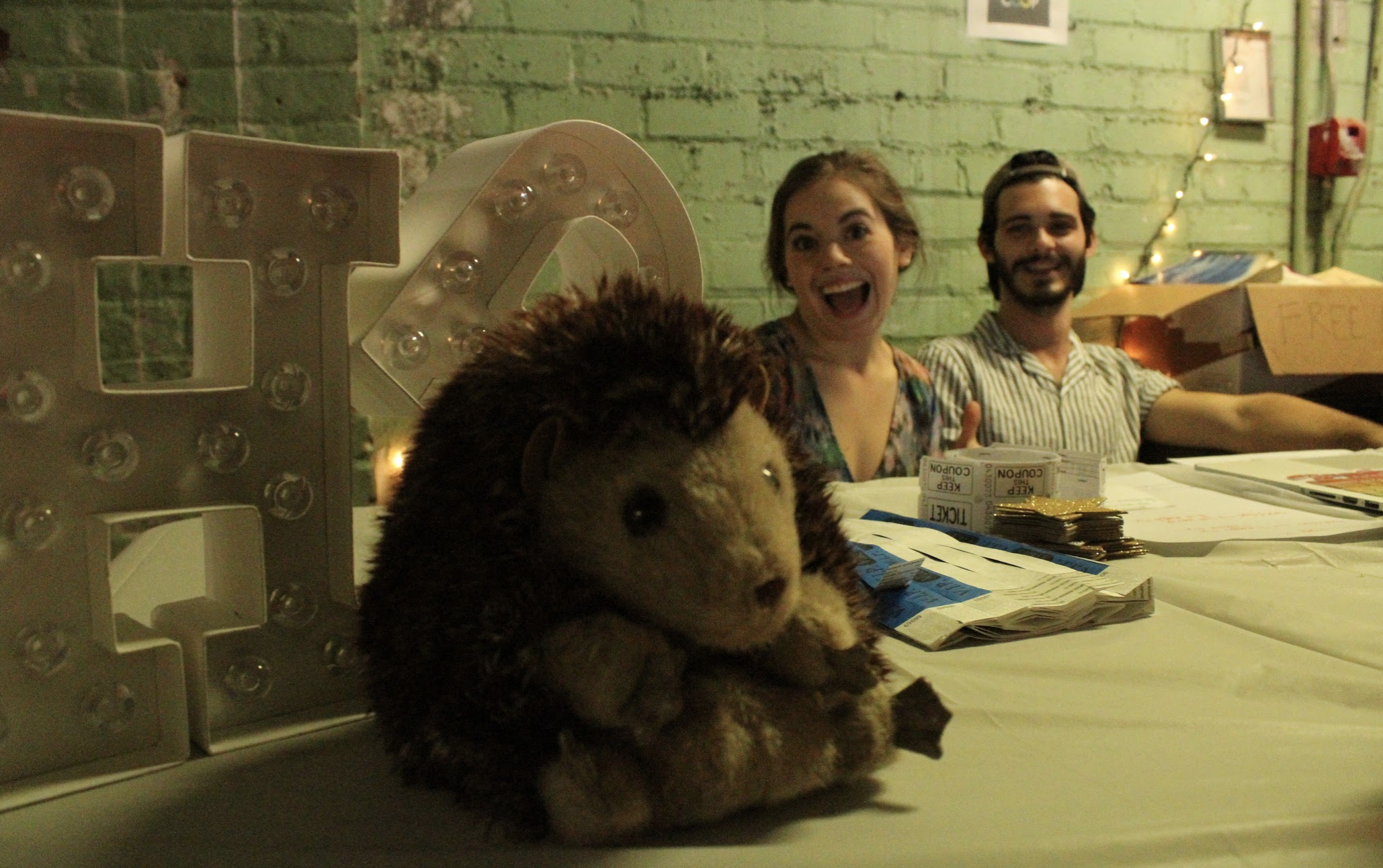 three happy pigs: alex, rachel, and a real (stuffed) hedgepig!