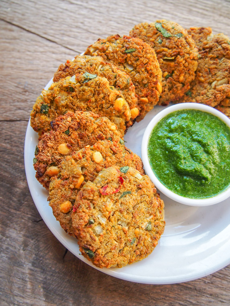 Baked South Indian Fava Bean Fritters with Green Chutney | vermilionroots.com. A version of popular tea-time snack Masala Vada that's baked instead of deep fried and includes fava beans.