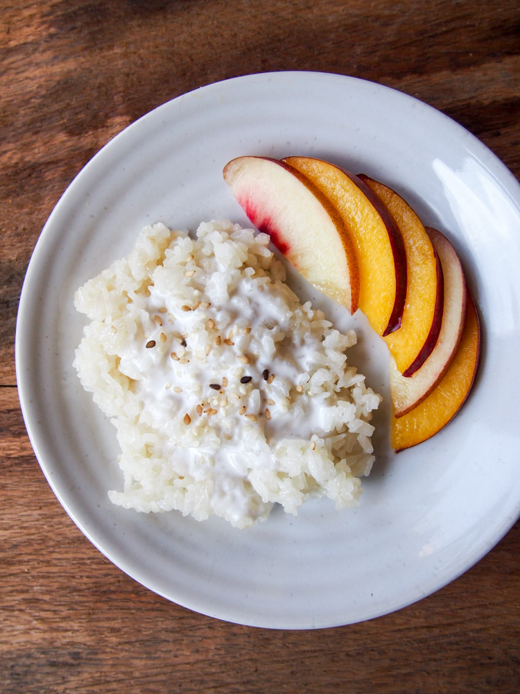 Coconut Milk Sticky Rice with Peach  |   vermilionroots.com  .  An indulgent Thai dessert to be enjoyed with your favorite summer fruits.