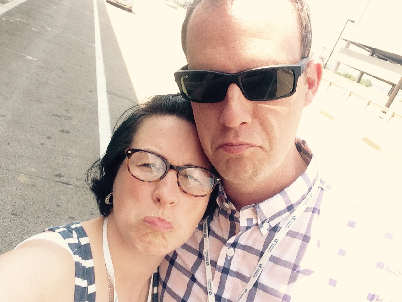 "Dropping him off at the airport. We did a ""frownee face"" selfie."