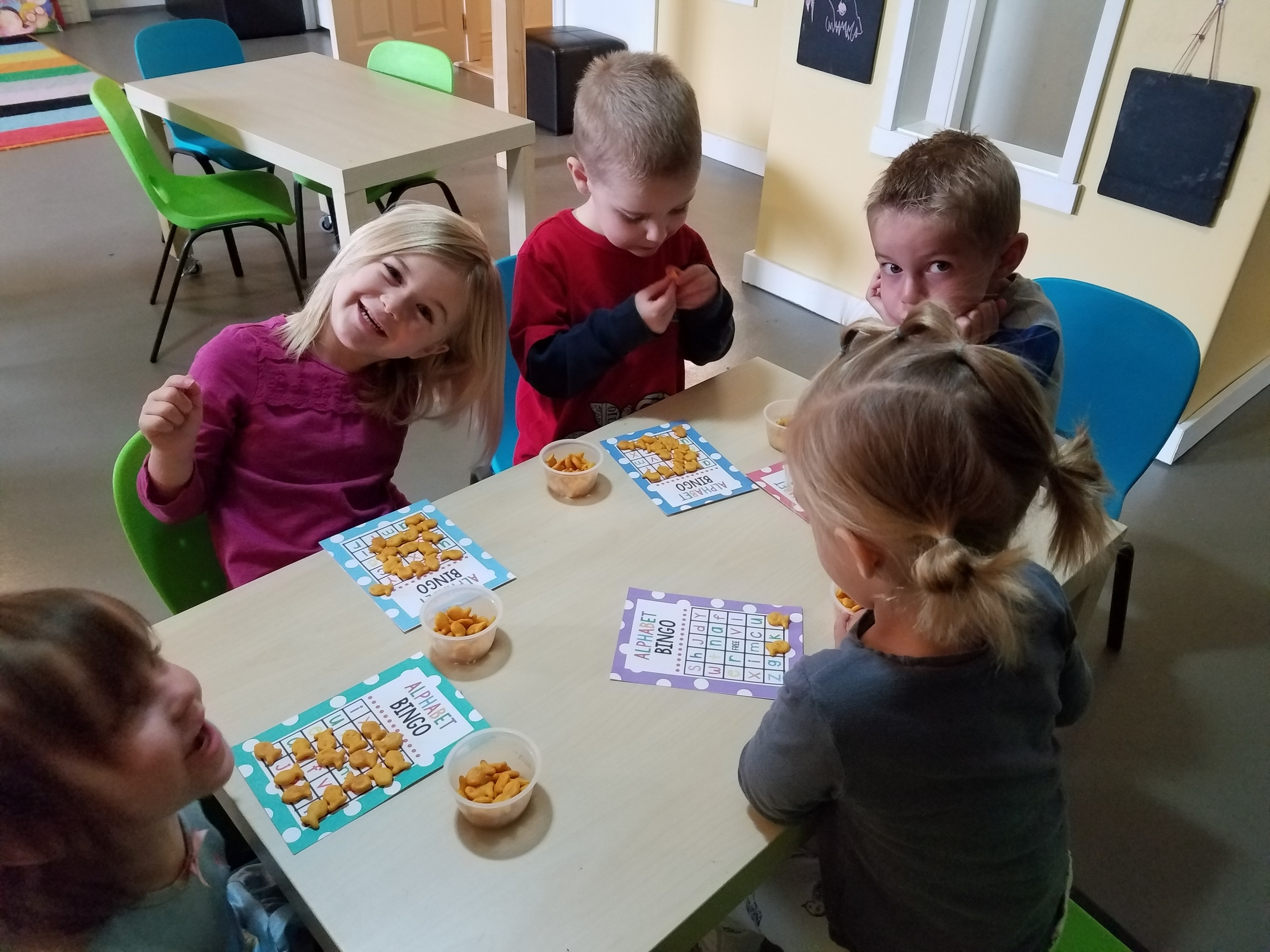 Playing Alphabet Bingo at snack time!