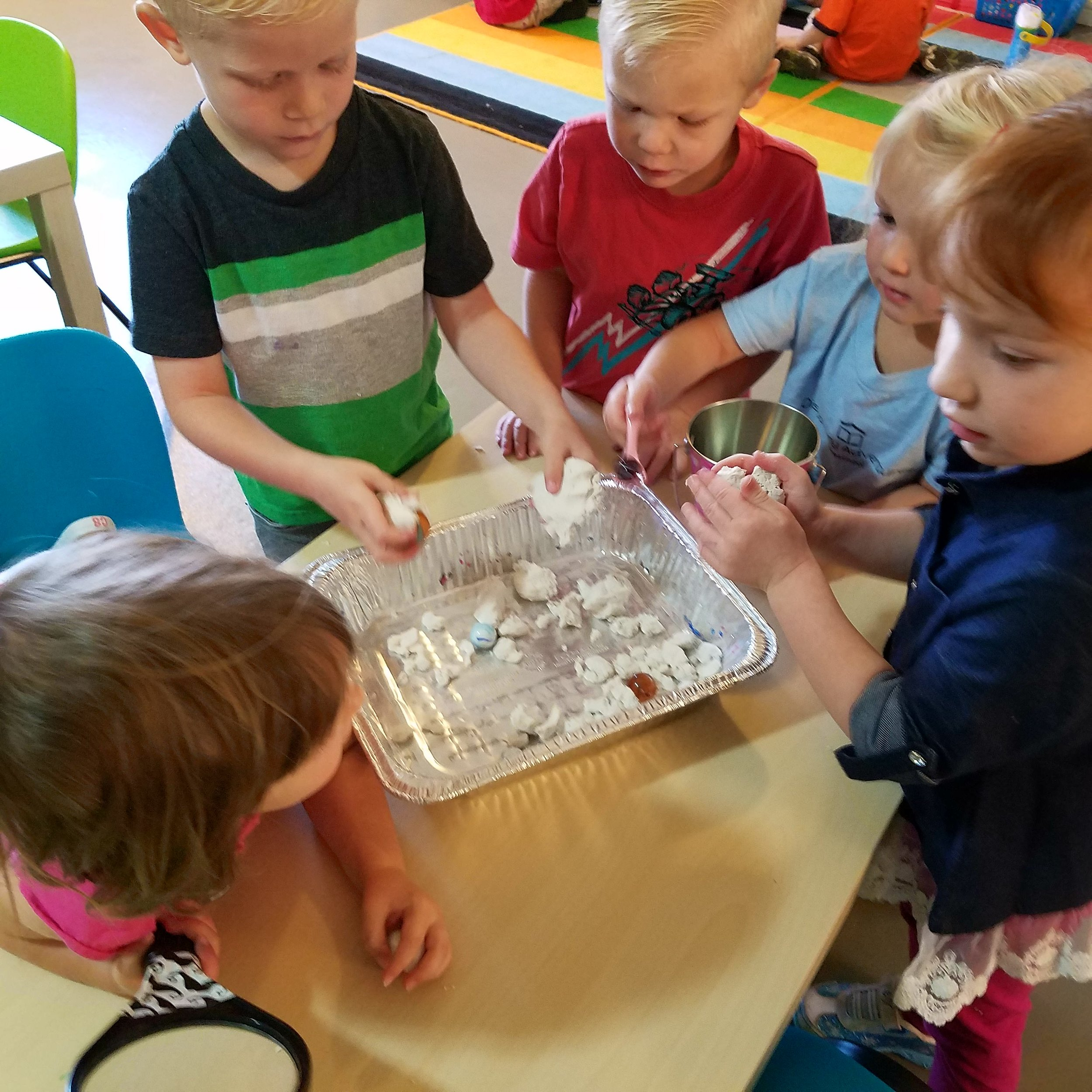 Moon Sand with Marbles, Magnets, and Magnifying Glass