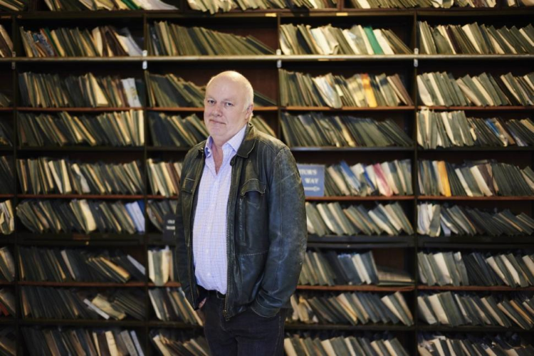 """Australian historian Shane White at the New York County Clerk Records office, which he said has """"the best set of records I have ever seen."""""""