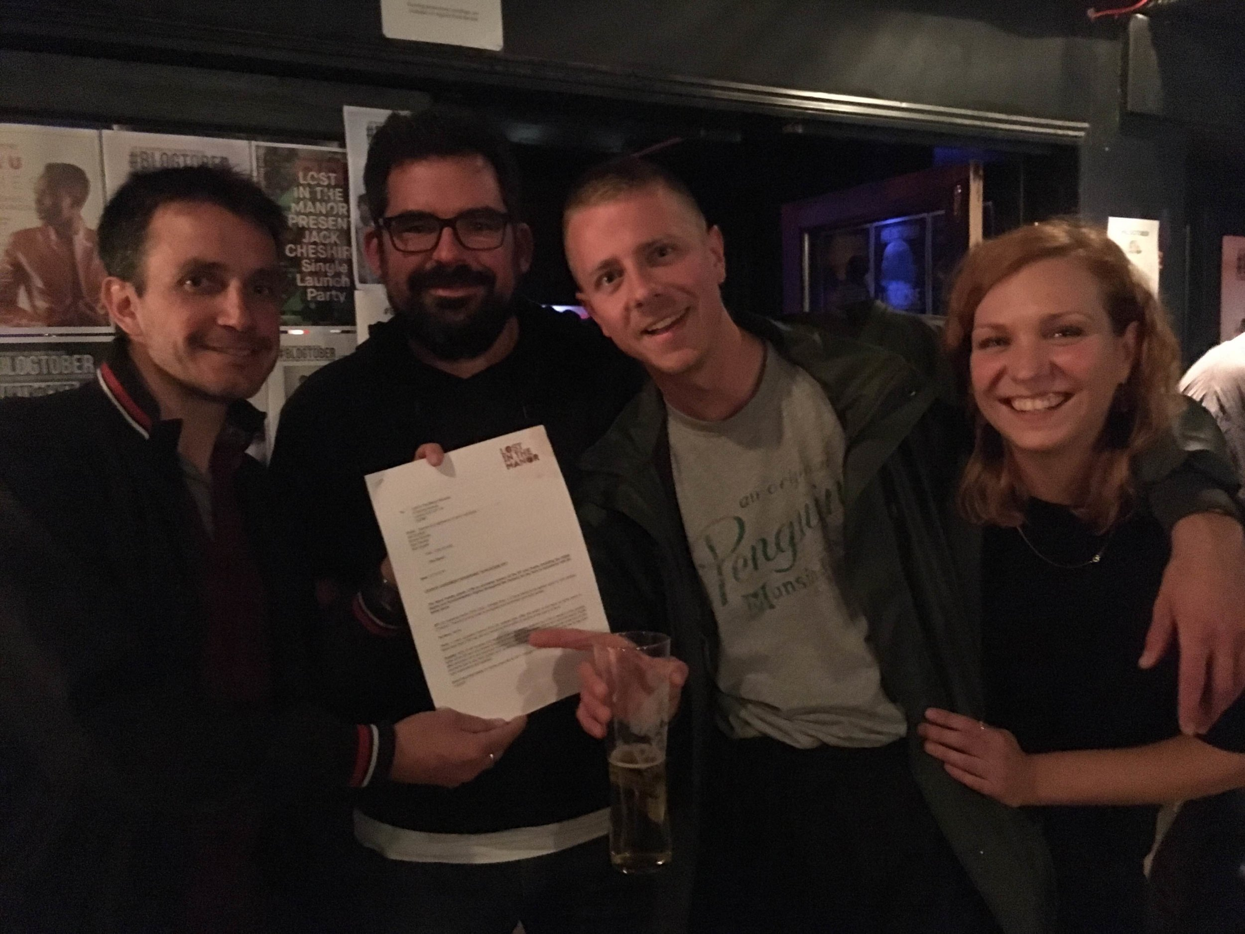 CHILDCARE frontman Ed Cares (second right) studies the small print with the Lost In The Manor team at The Finsbury