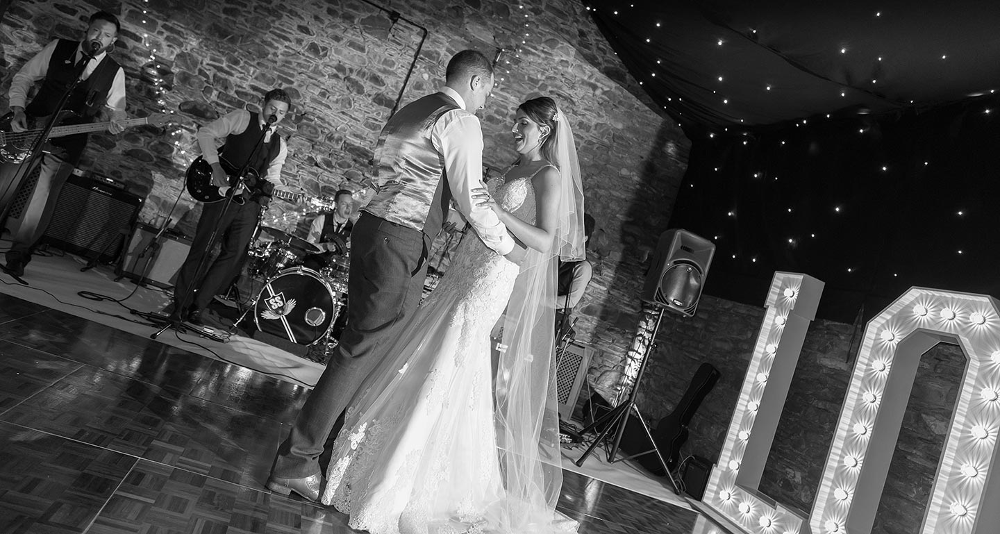 All smiles as 'The First dance' for Adam and Amy takes place on their rain affected day