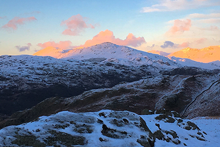 iPhone Image of the sunset with Harter Fell in shadow but the full glow of the sun on Bow Fell