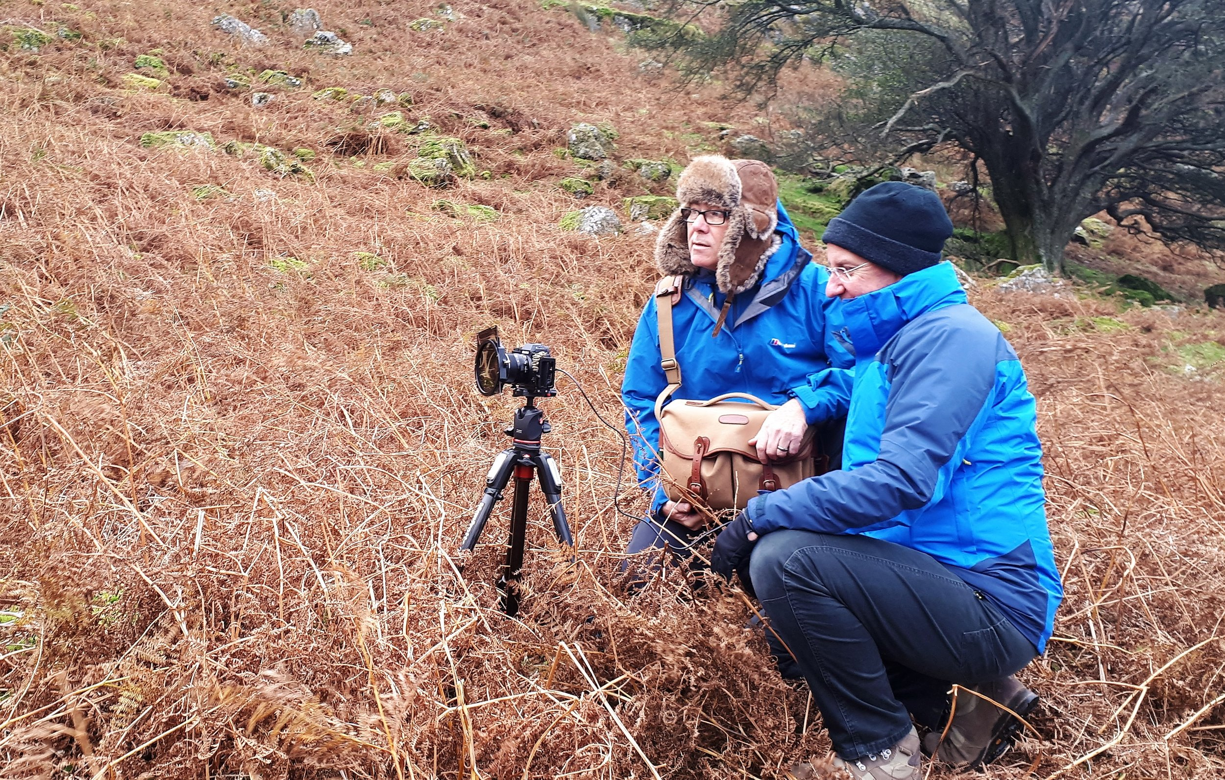 Sheldon on his second workshop with me this time at Rannerdale. Now using his newly acquired  FUJIFILM XT-2 . No Blue Bells at this time of year but still a beautiful place. My bald bonce feels the cold hence the trappers hat. My trusty old Billingham bag still looking good after all these years of service too. Photo by kind permission of Vicki Proctor.