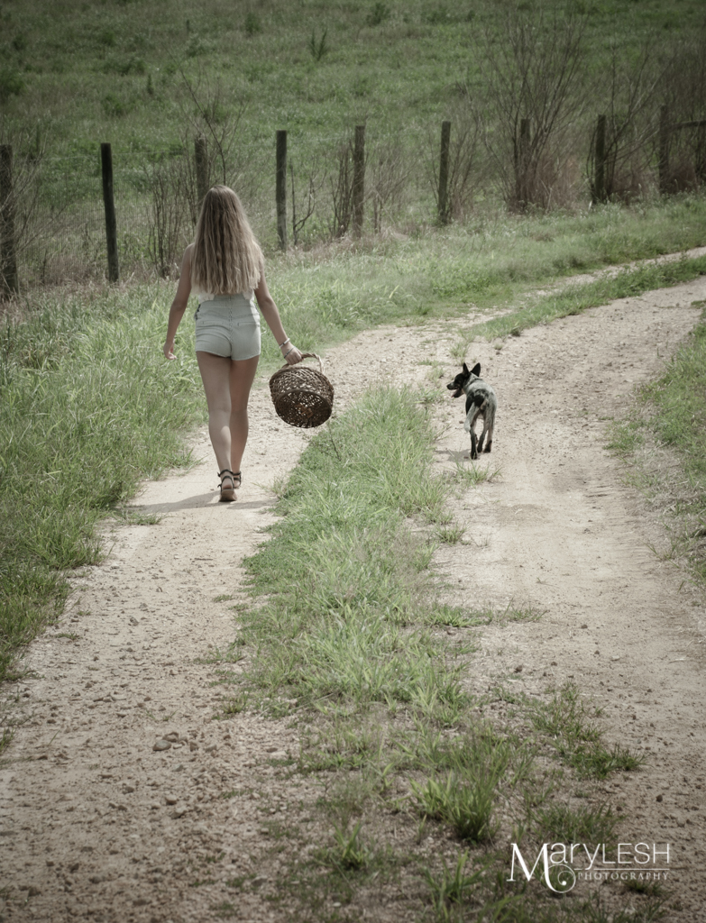 Strolling down the lane with a puppy.