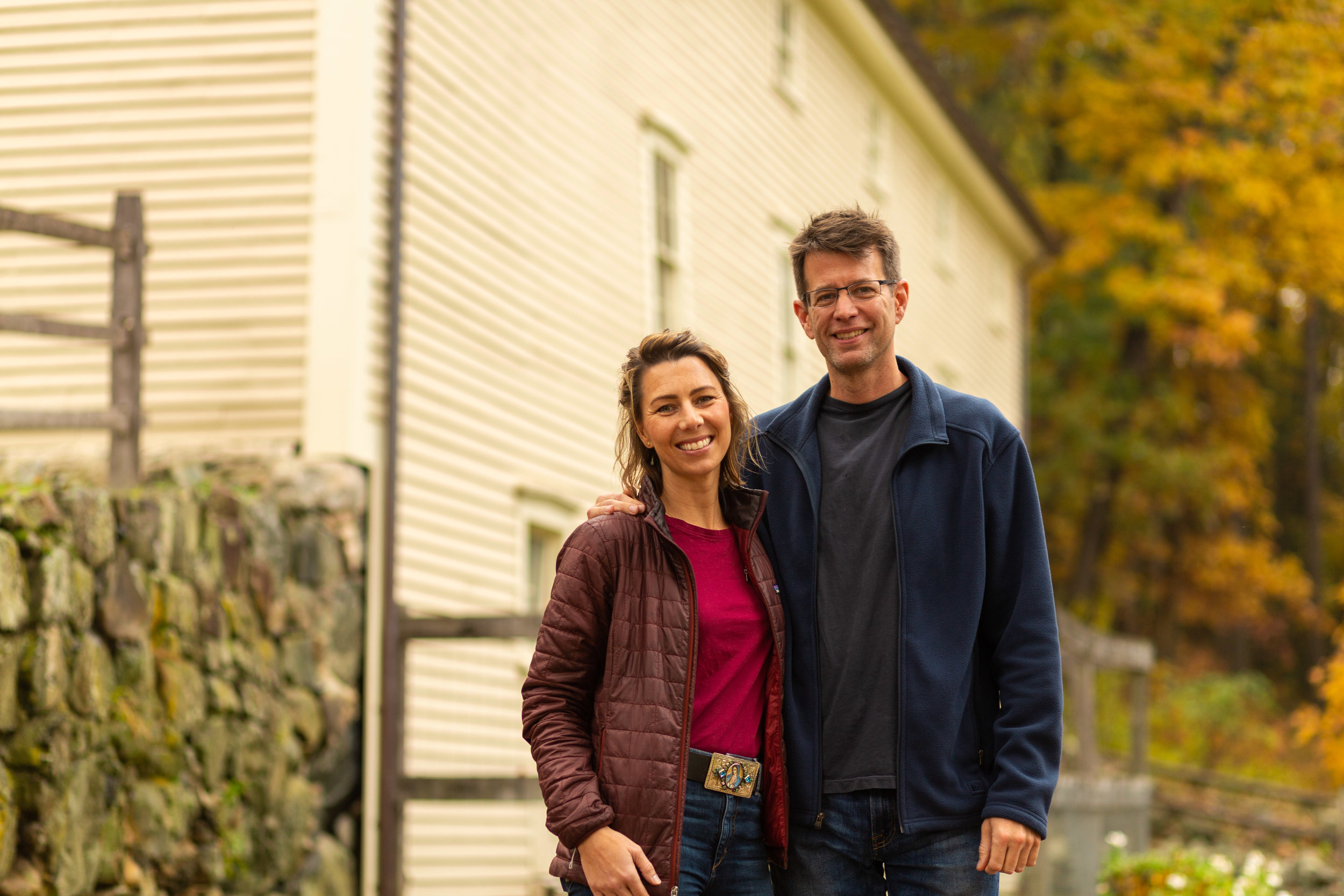 Monica and Tom Rogan, co-owners of Goodnow Farms, outside of their barn in Sudbury, MA