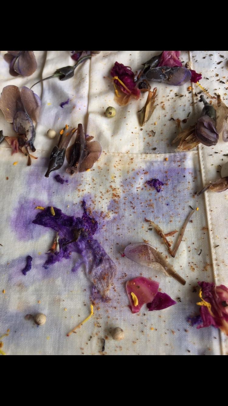 Iris, rose, marigold, and lupines.