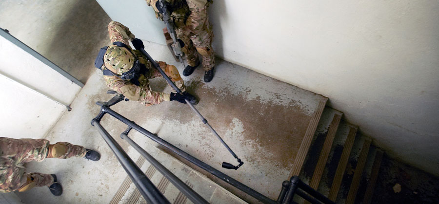 image-Wolf-Pack-search-pole-in-stairwell.jpg