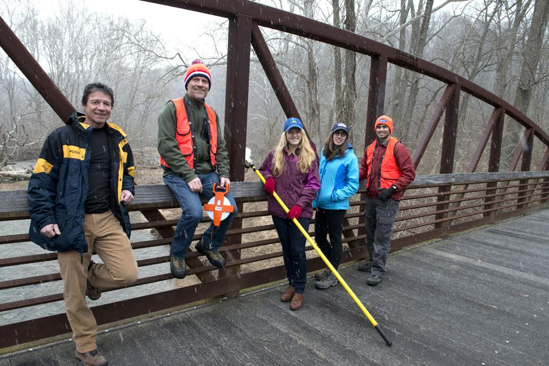 Kelsey Moxey (middle), lab group and University of Delaware professors Jerry Kauffman (far left) and Luc Claessens (second from left) sampling along the White Clay (c) UD CEOE