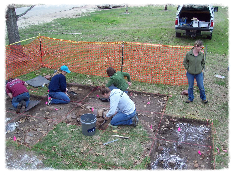 Members at cistern dig