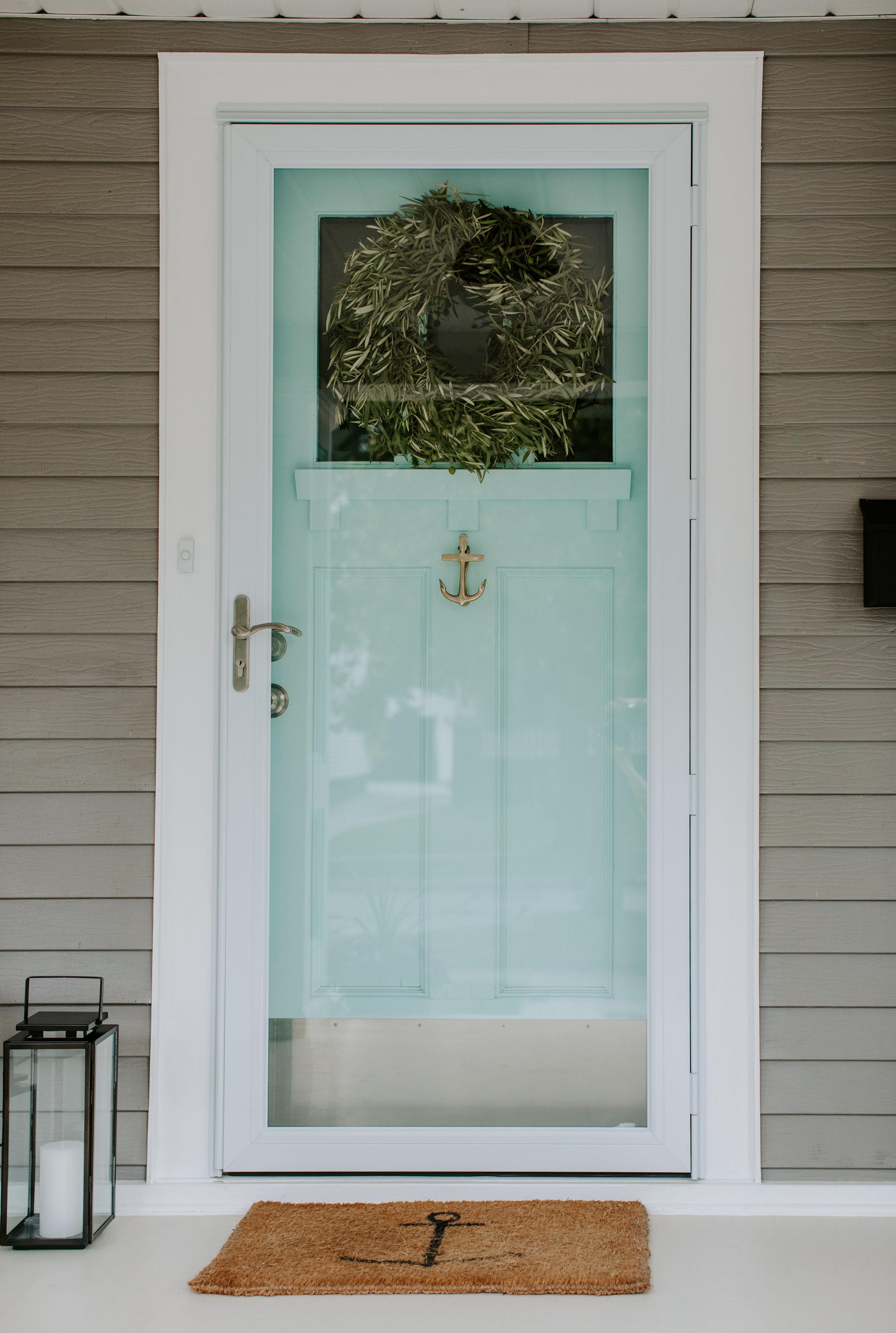 Coastal Aqua Front Door and Brass Anchor