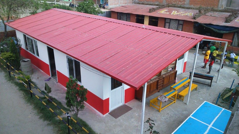 CYF's first fabricated house provided our children a temporary shelter from rainy nights.