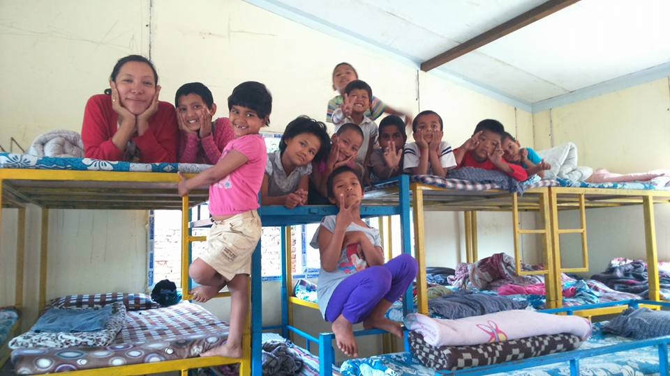 Haushala and the children in our first fabricated house