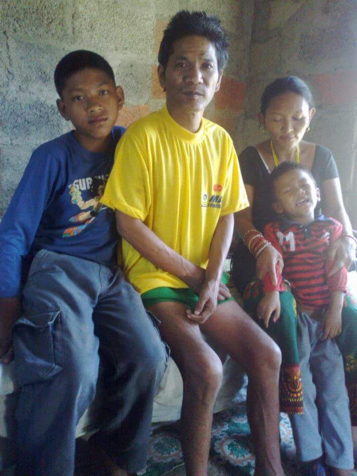 Young Anil (left) with his family