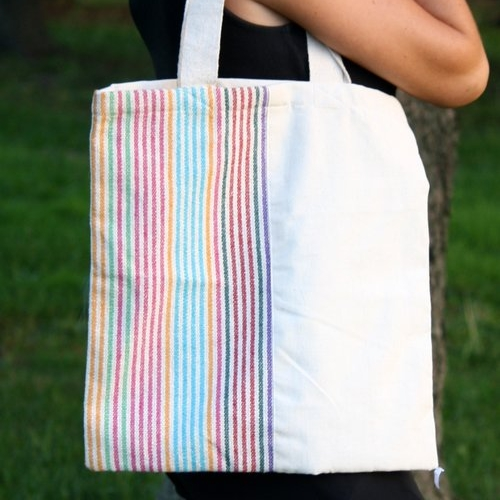 The Deepa Rainbow Tote,  $15  A great way to add color to an outfit, or show your pride! Just like our triangle tote, it's made of durable canvas on the outside with quick-dry nylon on the inside. One half features multicolored stripes: choose them either up the side or across the bottom.