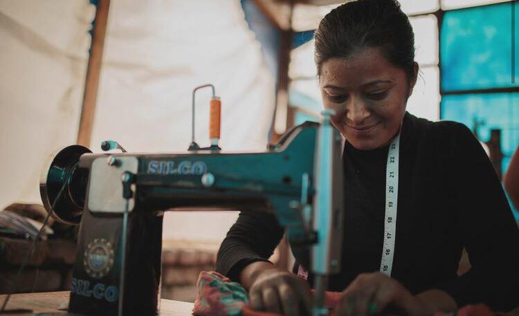Head stitcher Kamala Tamang sewing a Riya Tote in the Haushala Creatives workspace.