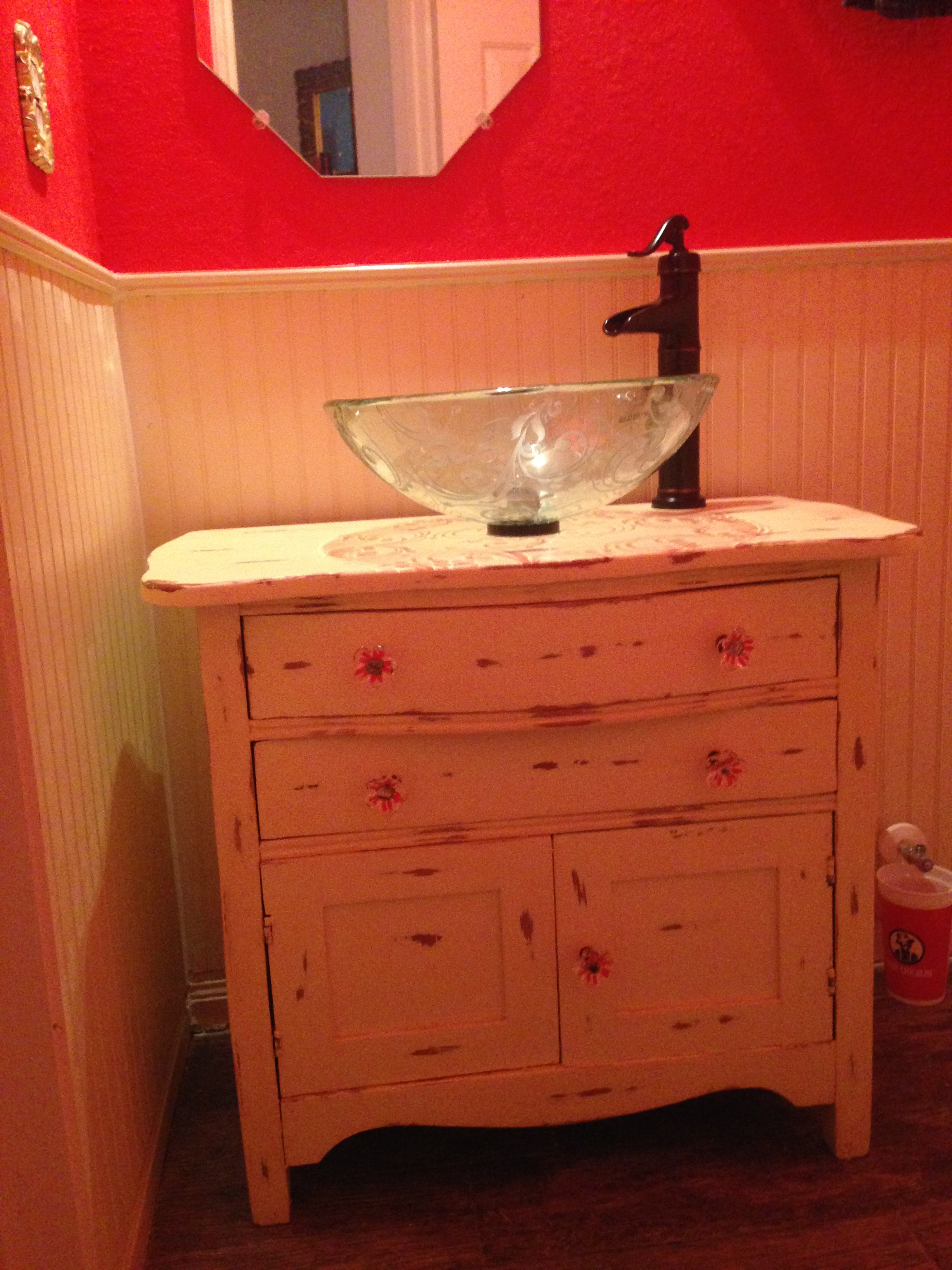 Wash stand painted, distressed and turned into a bathroom sink