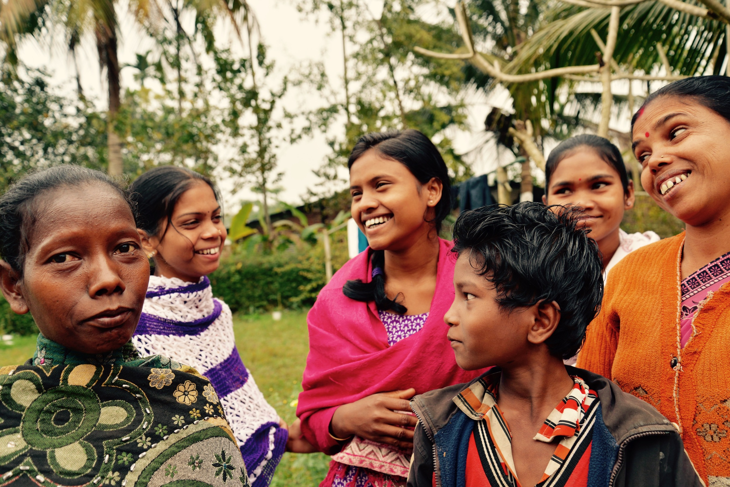 Sharing some laughs with the women who pluck tea at Pranjit's tea garden in Assam
