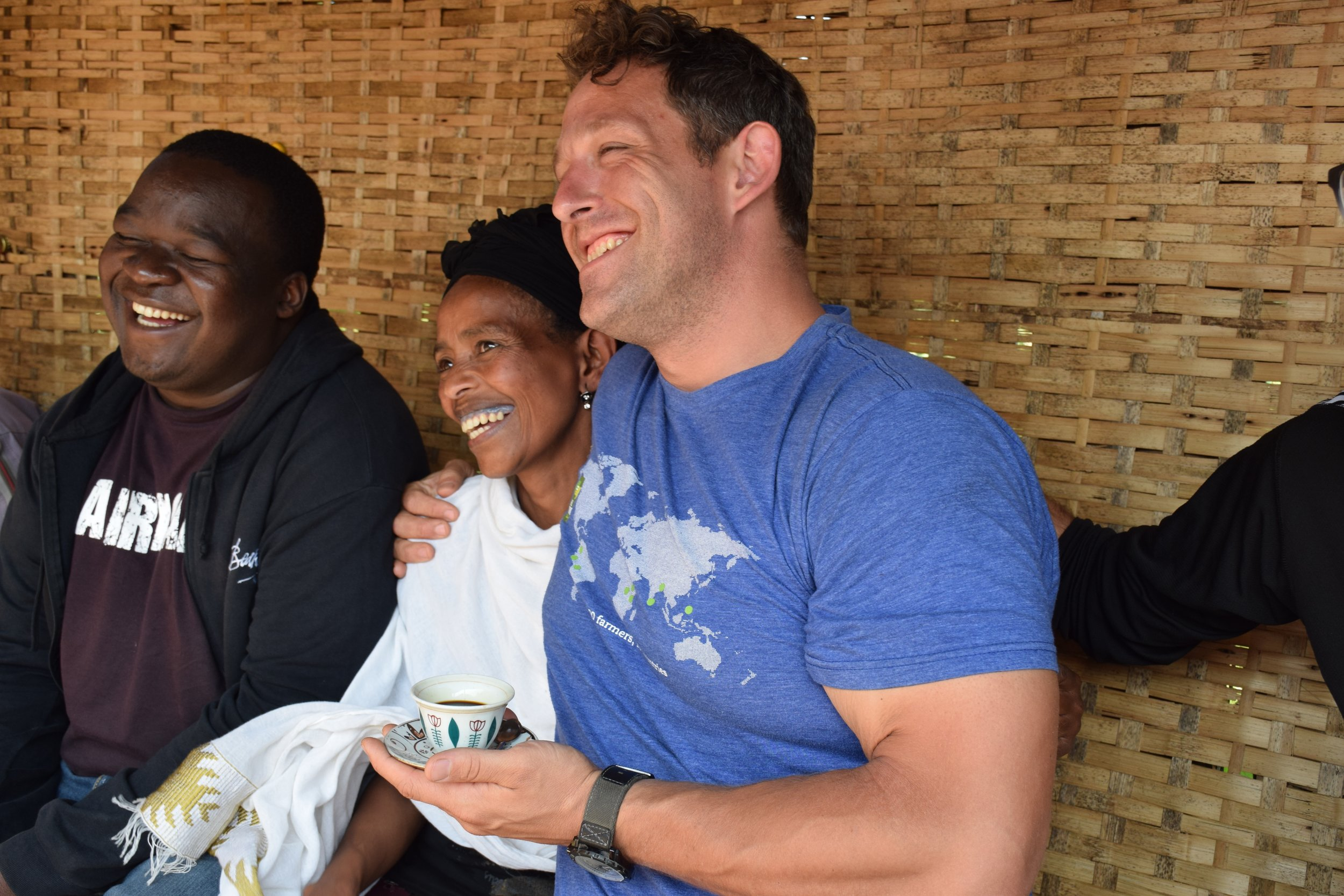 Roastmaster Josh (right), shares a laugh with our farming partners in Ethiopia.