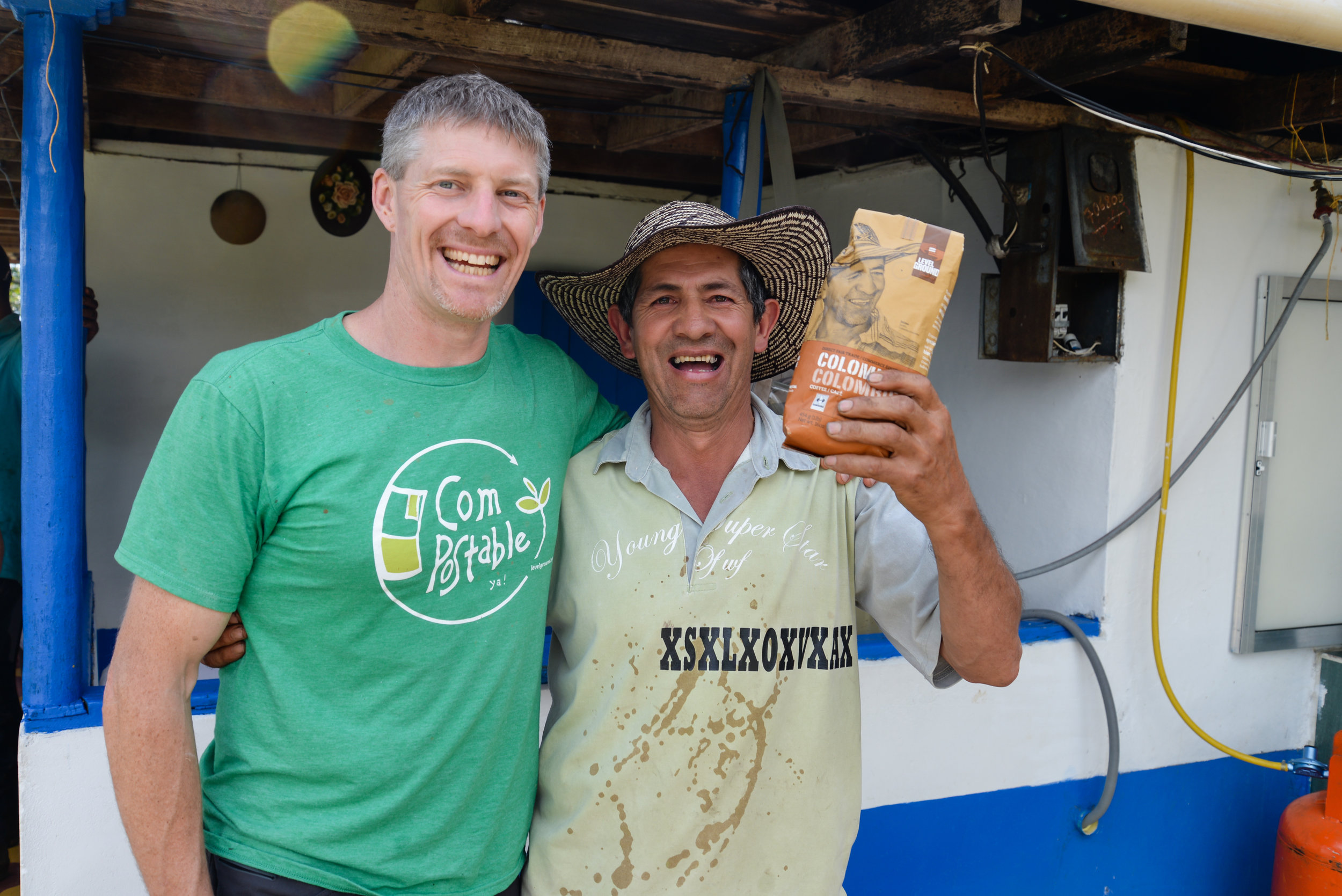 Co-owner Stacey shows Jaime his face on the Colombia coffee package for the first time!