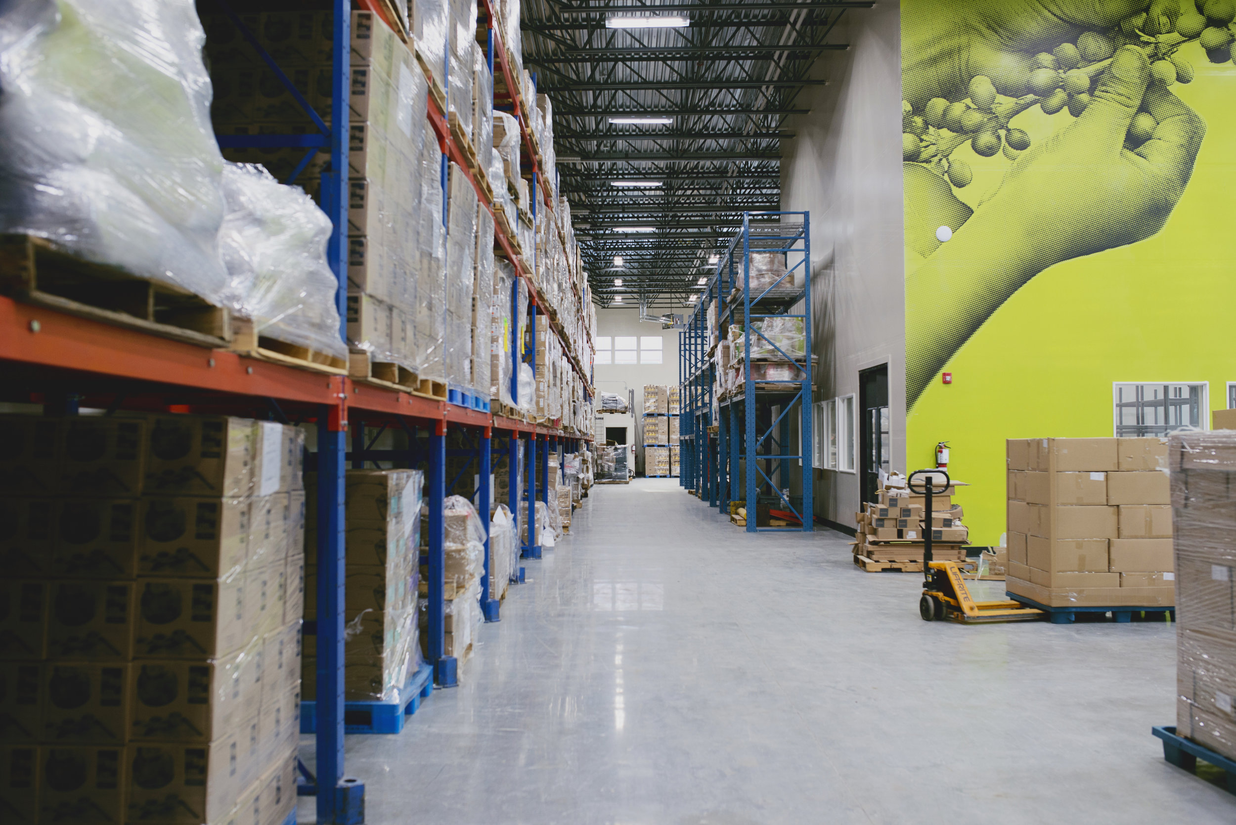 A view down our warehouse. The green mural wall is one of our favourite parts of the building!
