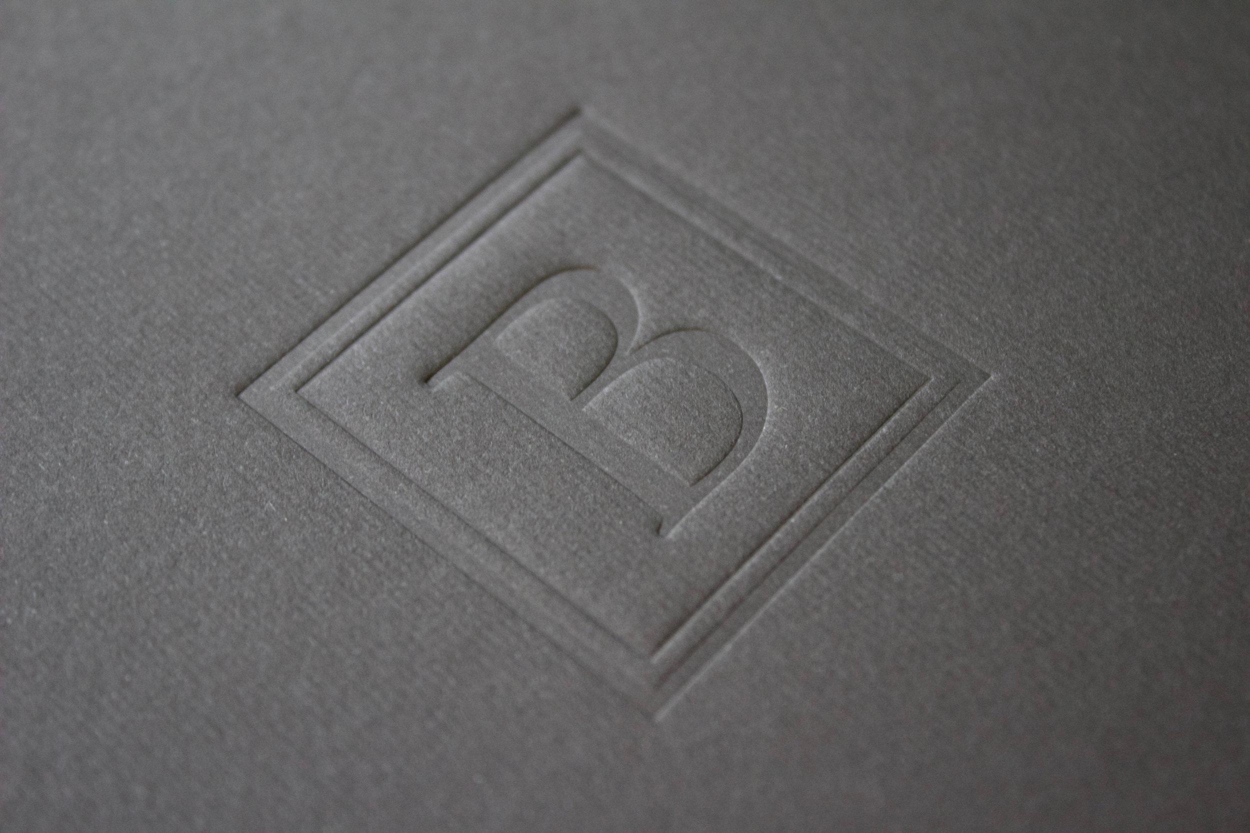Blind deboss logomark