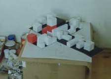 The black cube reveals white and red shapes which fill the inner void completely. Card stock, glue, tape.