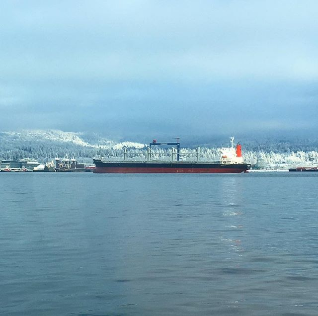 View of North Shore mountains from Sea Bus following snowfall last Wednesday morning. Seaspan and North Shore Automall are behind the freighter. #northvan #snow #translink