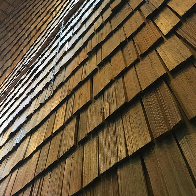 Hand-hewn cedar shakes in stairwell of North Shore Bowling. Interior designer unknown. Taken from @prosceniumarchid bowling and ski day this week! #cedar #cedarshakes #wood #northvan #vancouverarchitecture