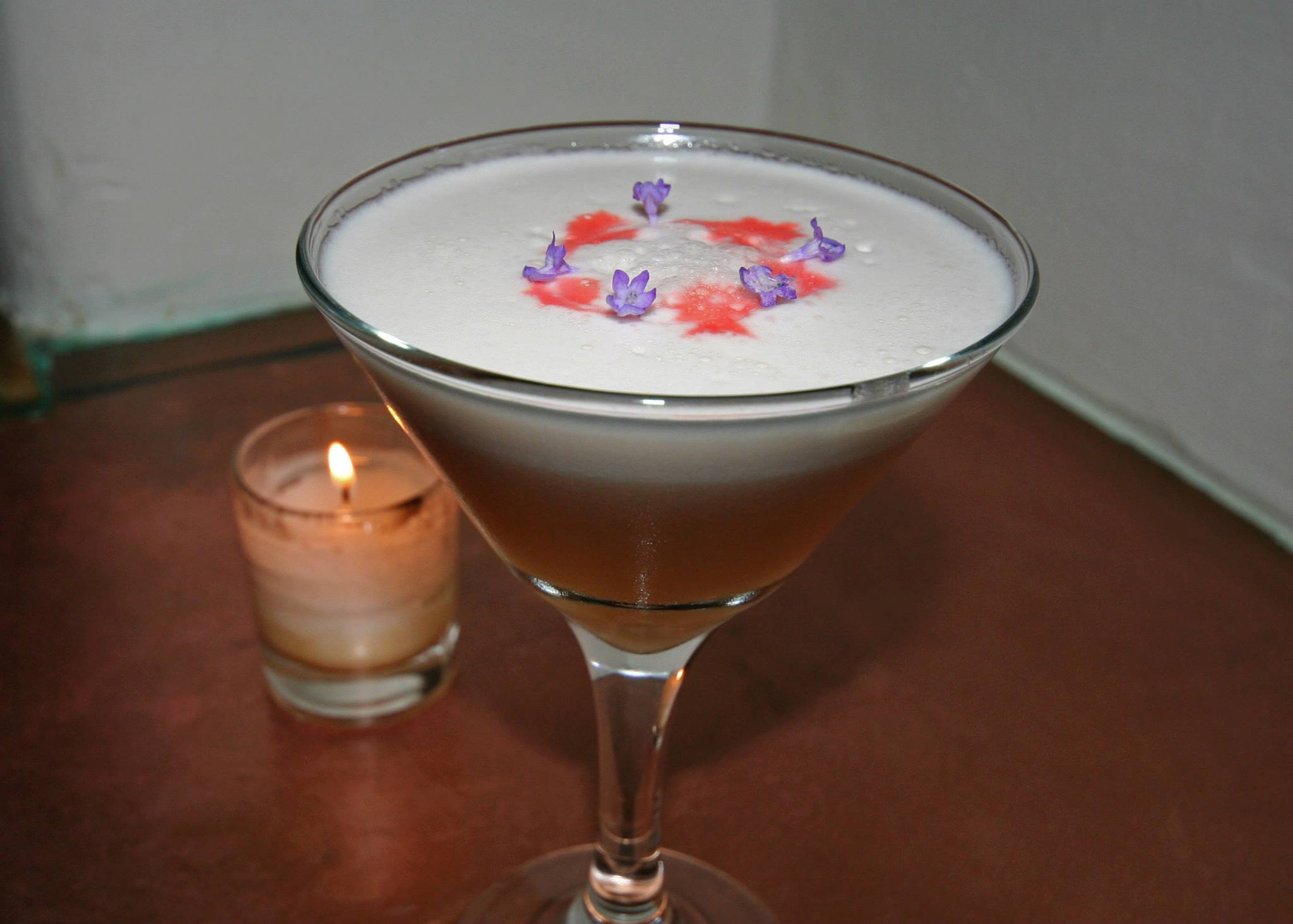 Pisco Sour with strawberry and lavender-infused Pisco Don César