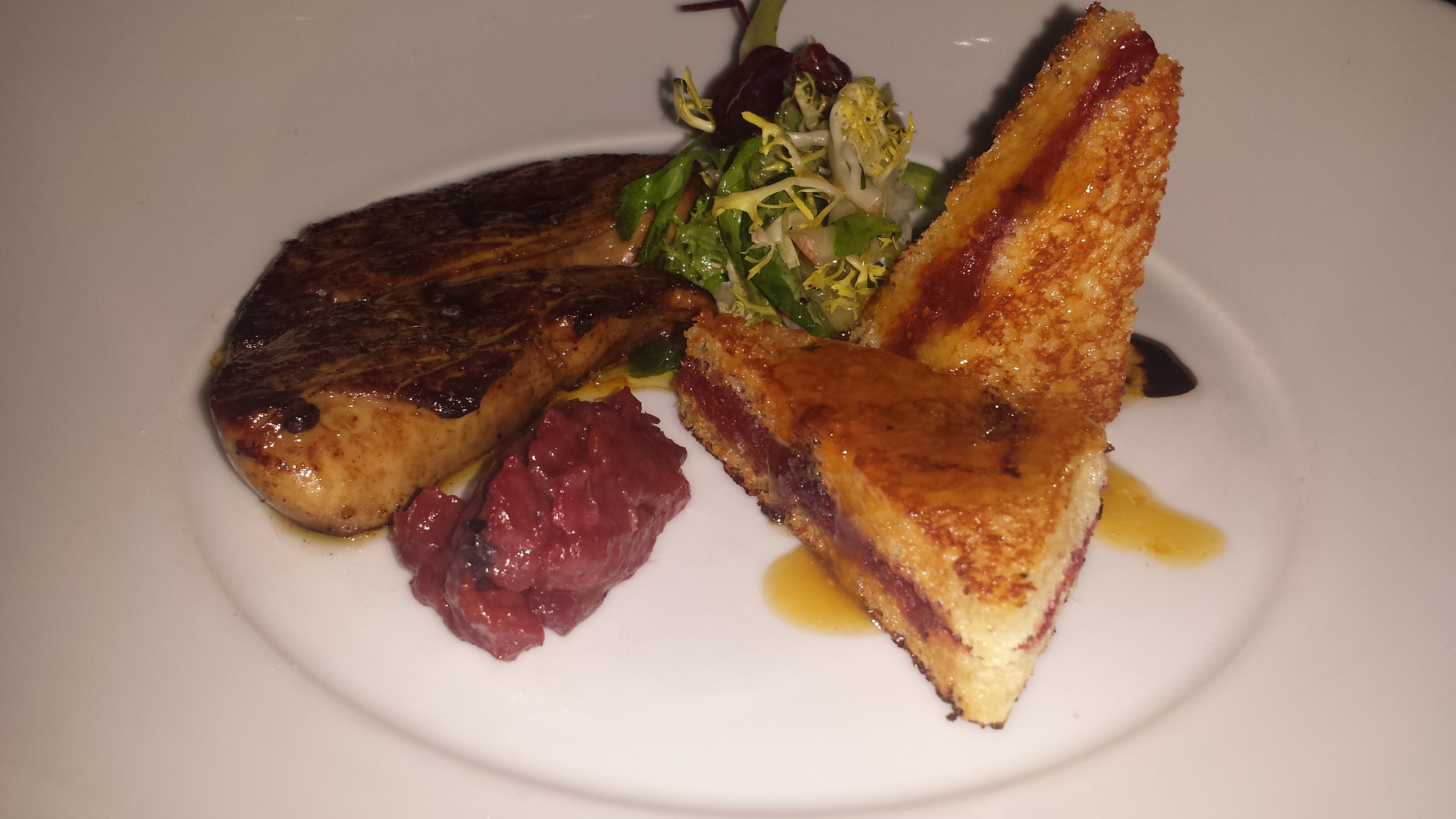 Seared foie gras with fruit compote and stuffed French toast.