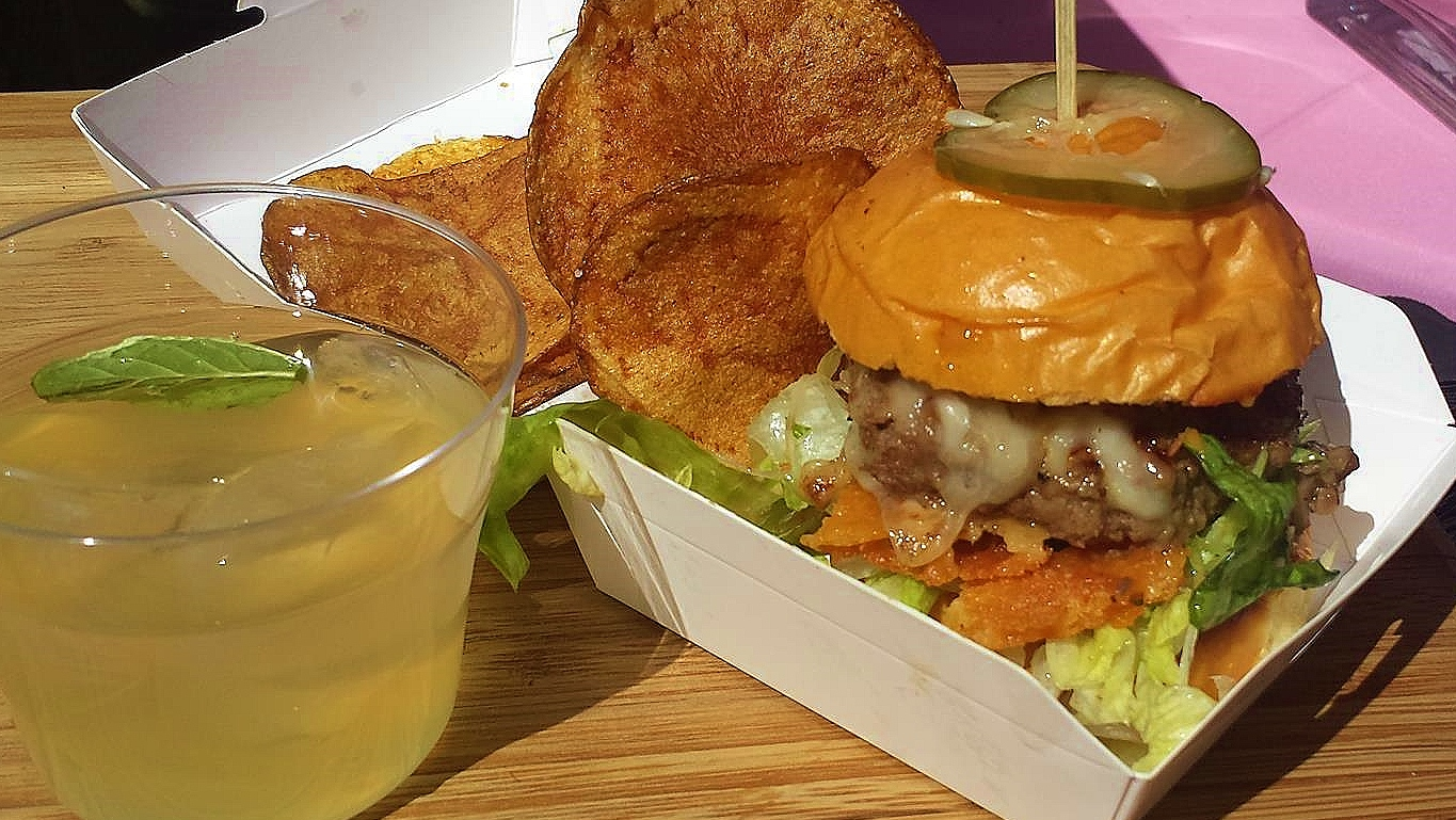 """Pink Pony's Umami Bomb Burger + """"No-Jito"""" mock cocktail with ginger beer, lime, and mint."""