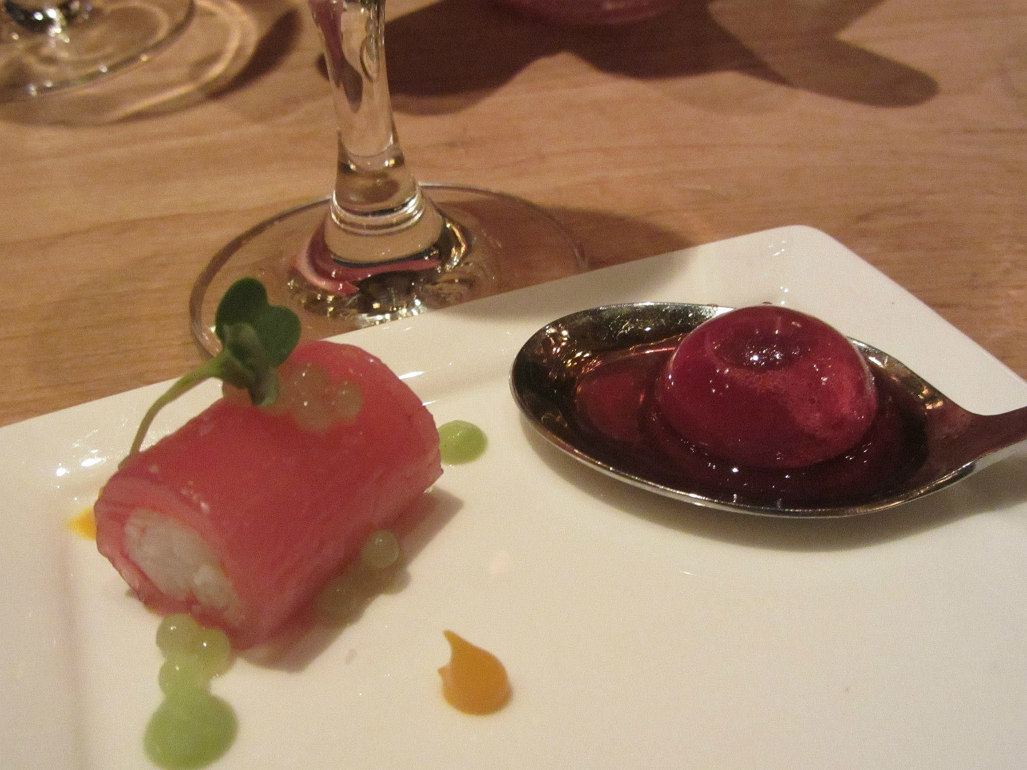 "King crab and tuna roulade with green apple caviar and mango puree, and a ""cherry bomb"" with verjus."