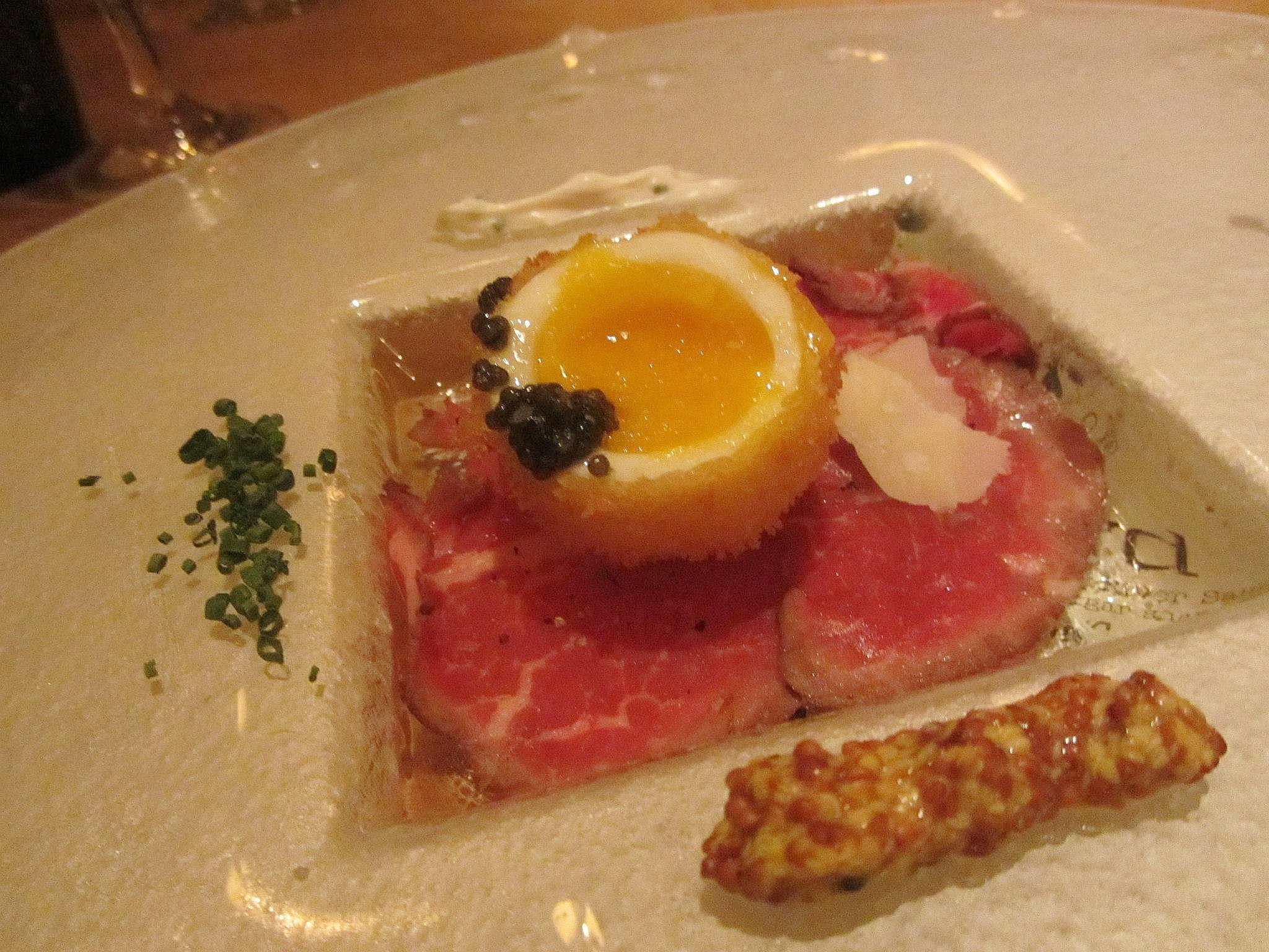 Cedar River carpaccio with caviar and a crispy egg.