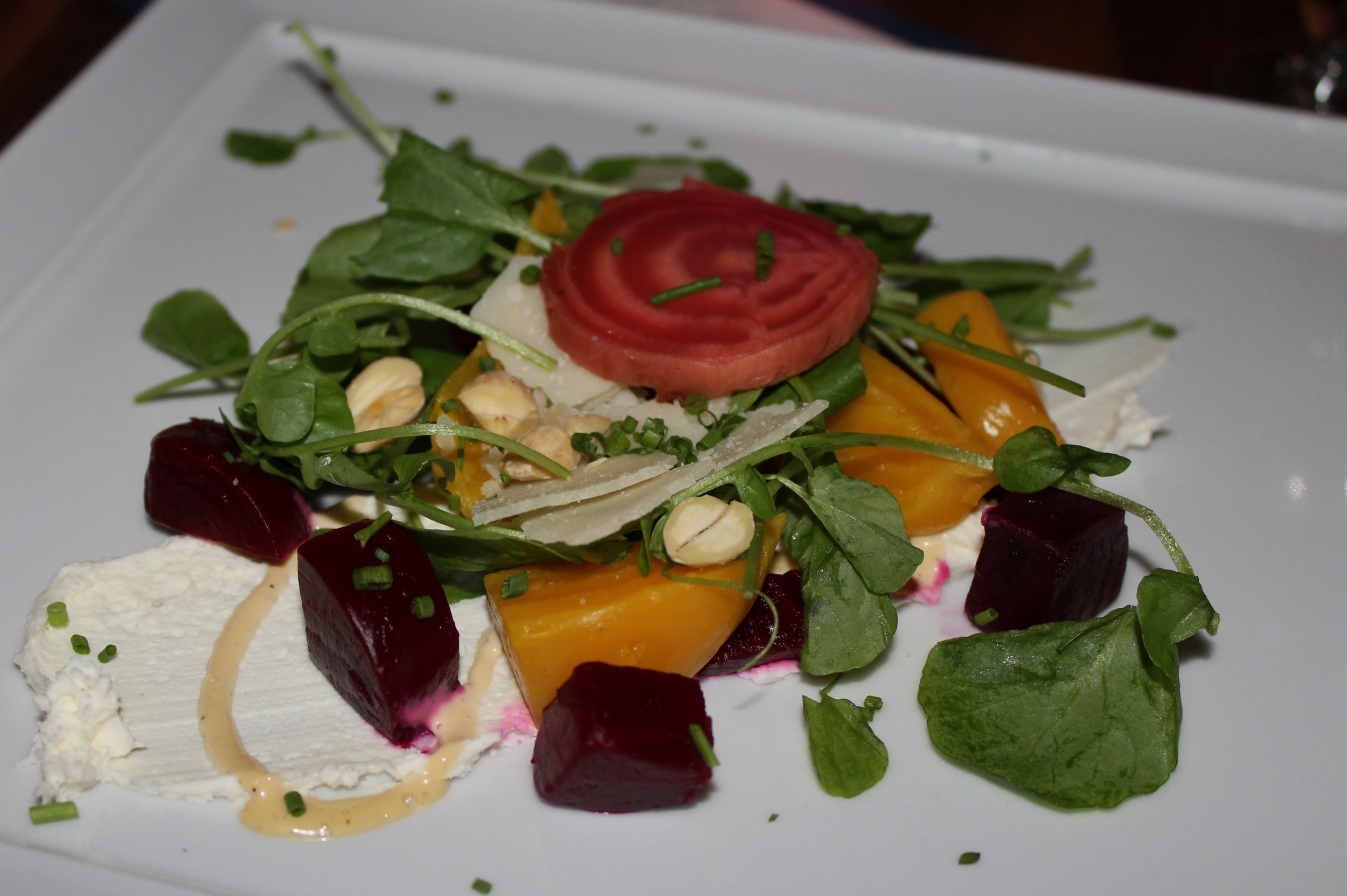 beets with watercress, Marcona almonds, creamy mascarpone, parmesan, and maple-sherry vinaigrette.