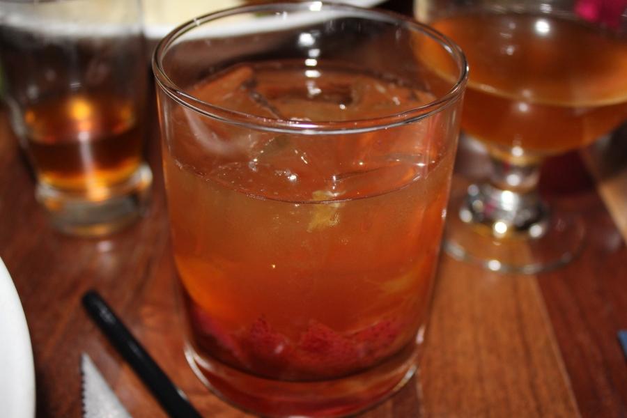 """""""Strawberry New Fashion"""" ( Arizona Distilling Co. Copper City Bourbon, AZ Bitters Lab Mi Casa Bitters, Carpano Antica, Demerara sugar cube, orange and strawberries)."""