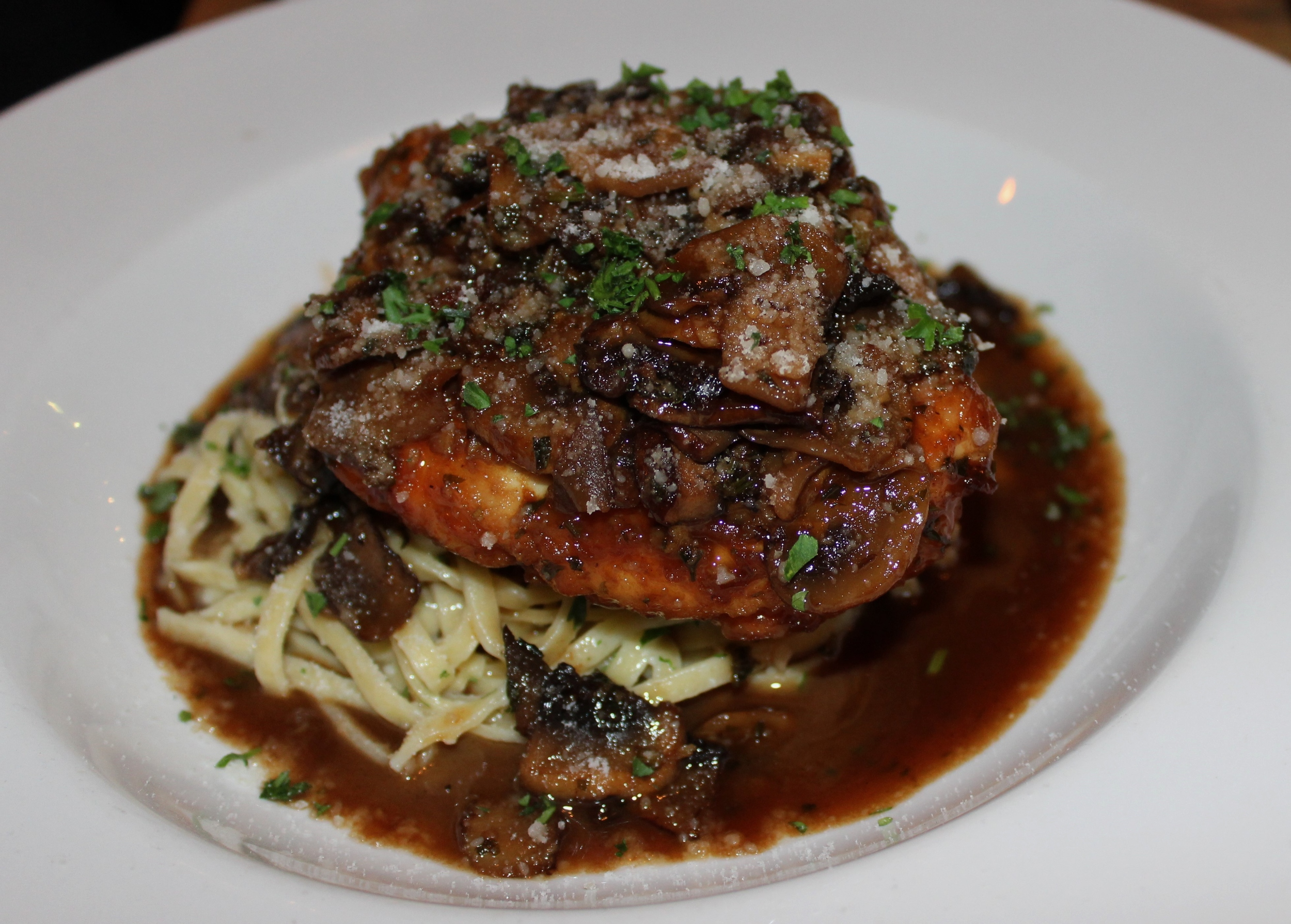 Chicken marsala with fresh  linguine, sherry mushrooms, and Grand Marnier