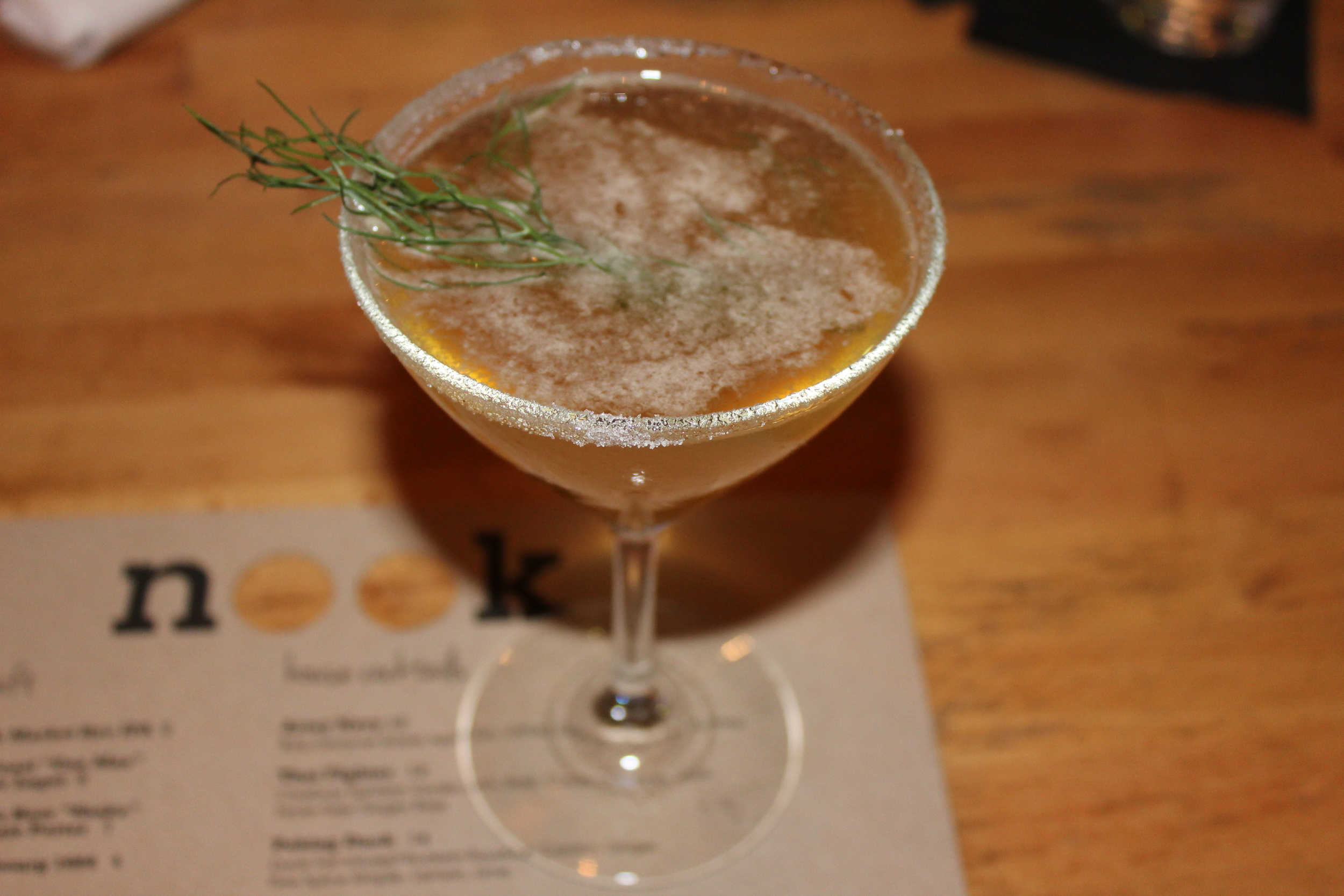 Seasonal Sidecar (H by Hine cognac, Yellow Chartreuse, carrot simple syrup, and lemon)