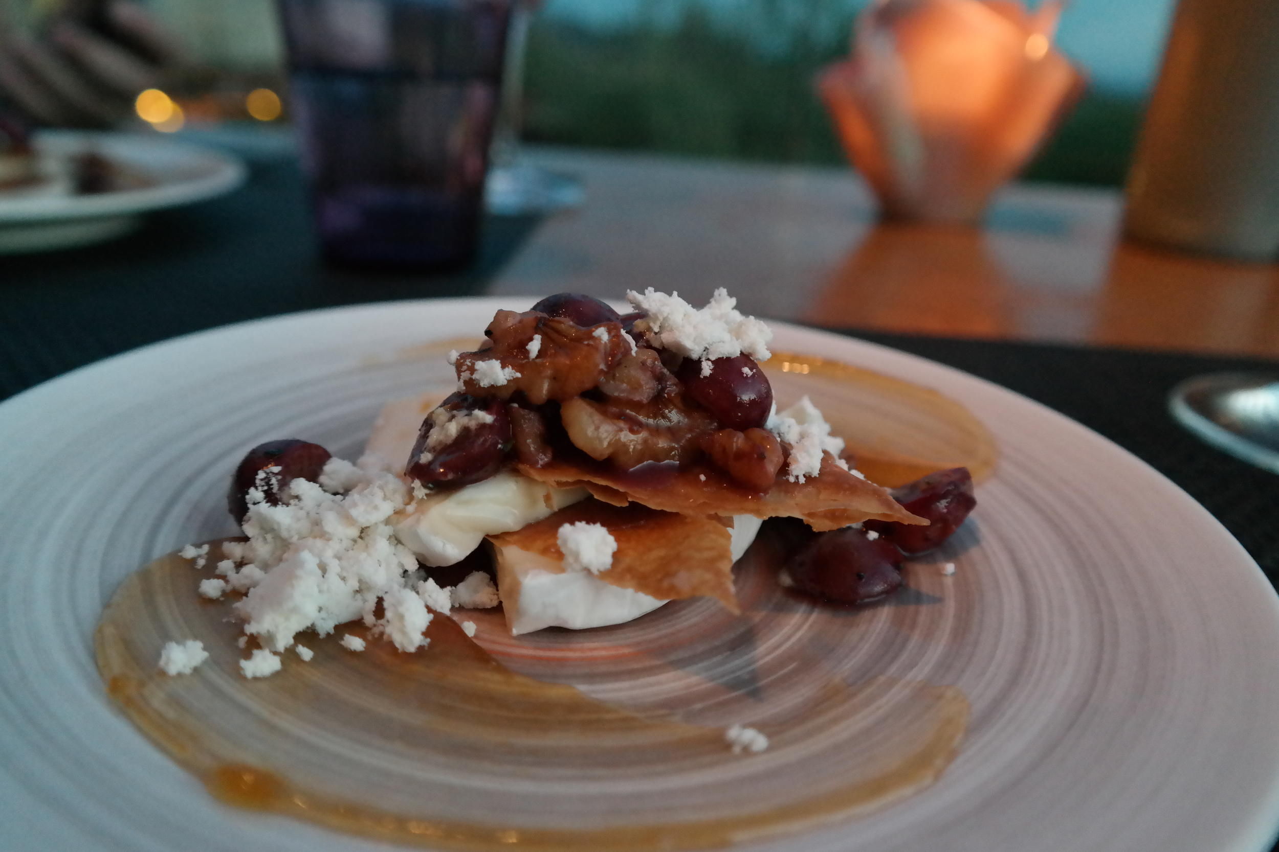 Triple creme brie Napoleon with grapes, walnuts, olive oil powder and apricot marmalade.