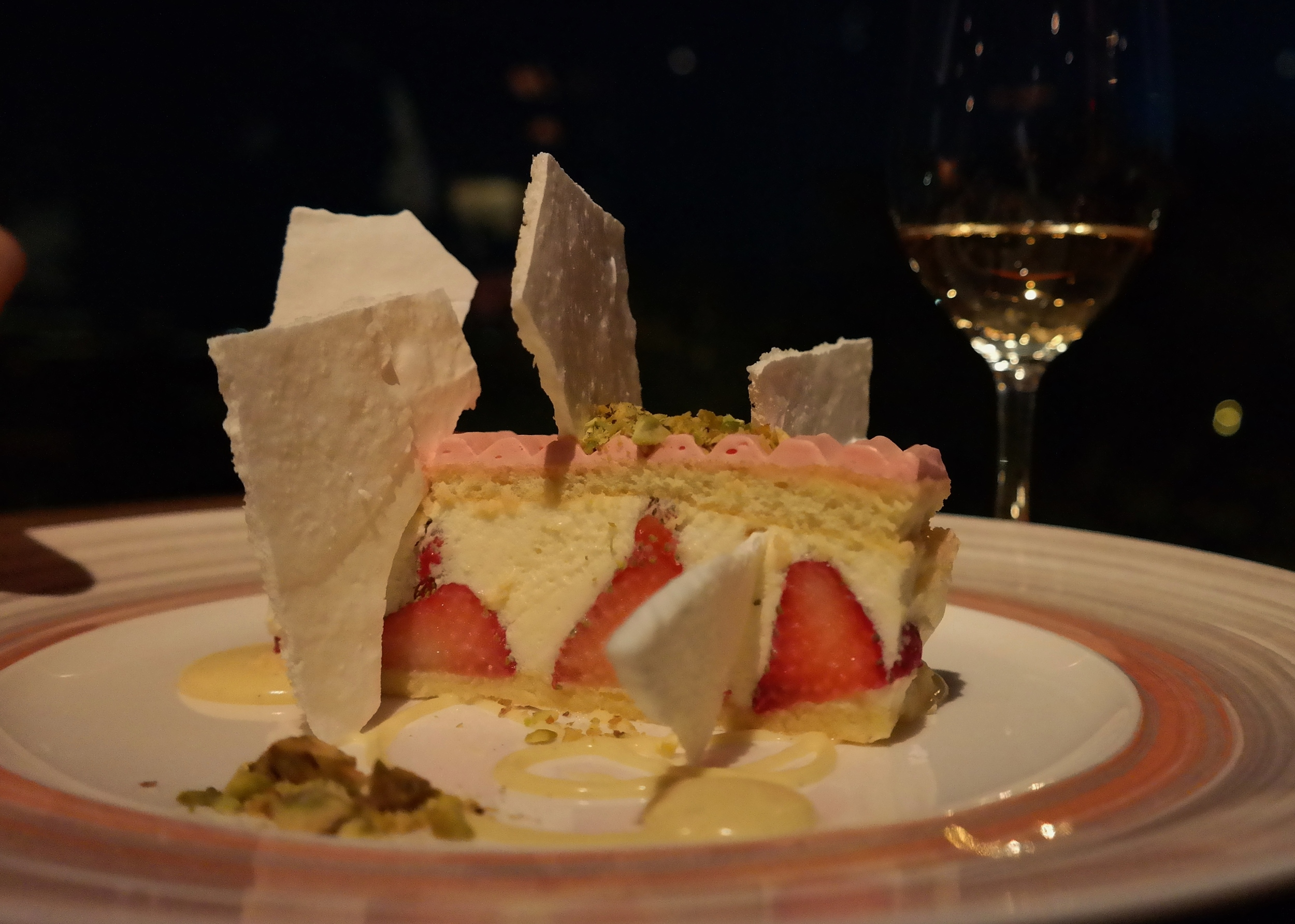 Strawberry cream cake with Grand Marnier, pistachios, and crispy meringue