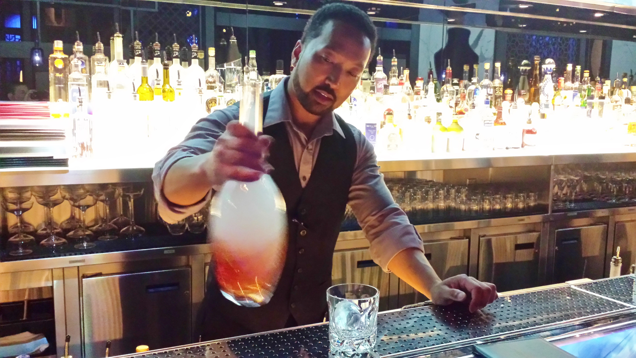Adrian mixing up a Smoky Negroni