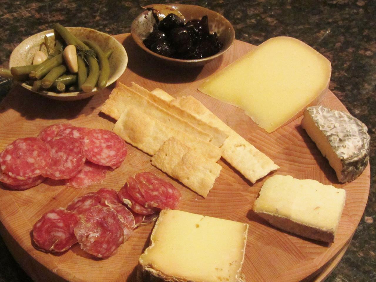 Tartufo salami, sopressata, Mean Beans and red wine figs, Uplands Pleasant Ridge Reserve, Fiore di Capra chevre, Landaff tomme, and Vacherin Fribourgeois