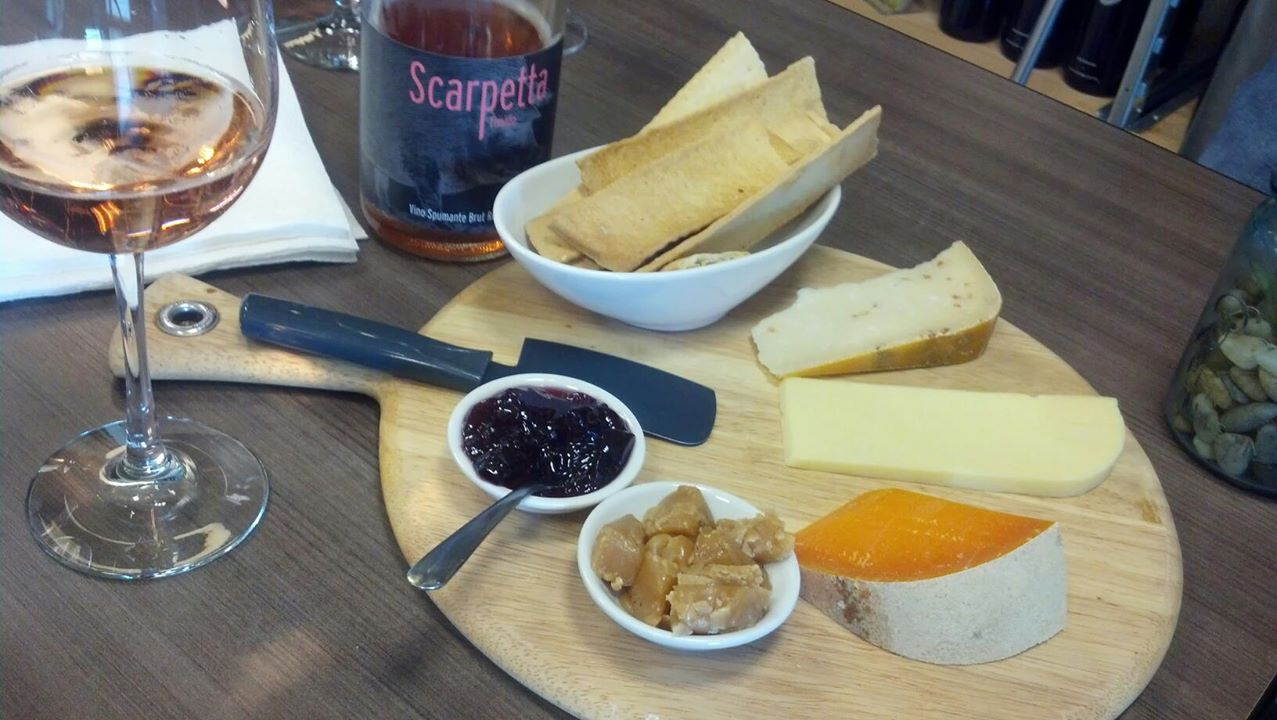 Mimolette, Eiger Mountain Gouda, Fenacho with fenugreek seeds + cabernet jelly and vanilla salted caramels, and Scarpetta rose.