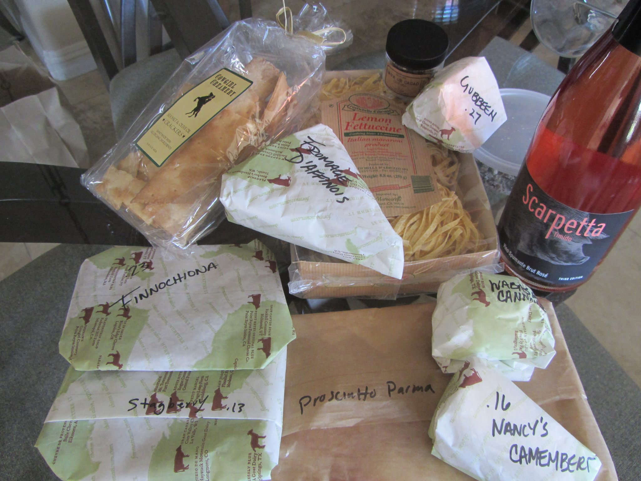 Fromager d'Affinois, Wabash Cannonball, Camembert, Gubbeen, Prosciutto di Parma, finocchiona, Stagberry elk and blueberry salame,  pasta, cocoa nibs, crackers, Caravalgio salted capers