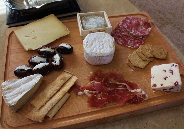 AZ Dates stuffed with Crow's Dairy goat cheese, Flory's Truckle, Bonne Bouche, finocchiona, stilton with cranberry, Surryano ham, Mt. Tam.