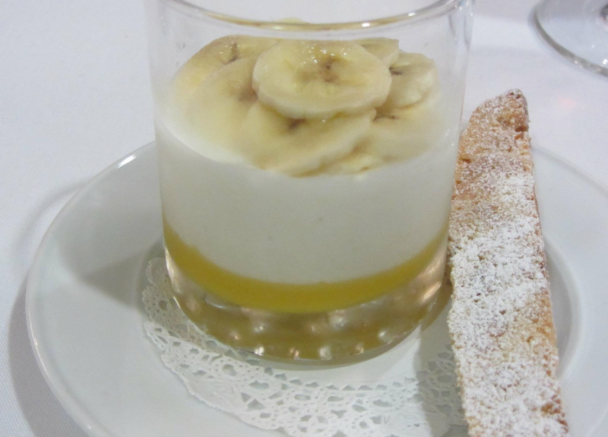 Panna cotta with passionfruit curd and banana-macadamia biscotto